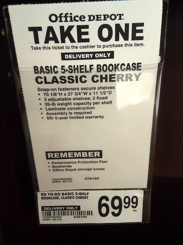 "The ""take one"" slip for one of Office Depot's 5-shelf bookcases I use."