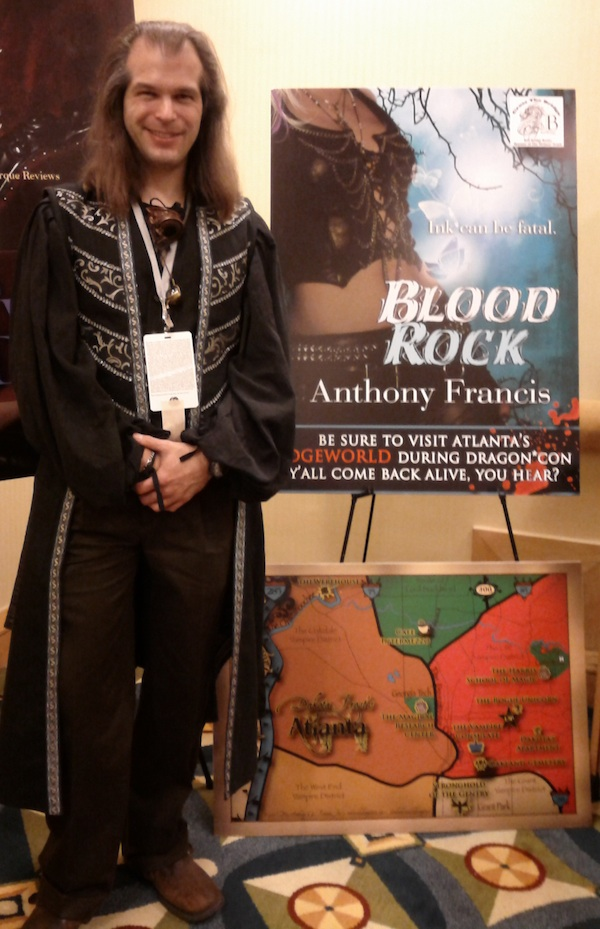 me in front of the bell bridge books promotional material for BLOOD ROCK